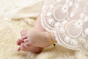 image of a baby`s feet at her christening