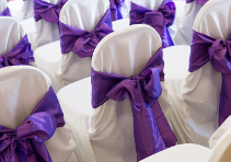 image of Chairs covered for a wedding at Roundwood in Norwich