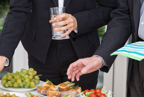image of 2 businessman at a buffet table