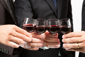 image of businessmen drinking red wine