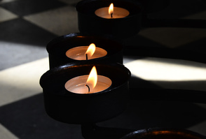 image of a candle from a wake at Roundwood in Norwich