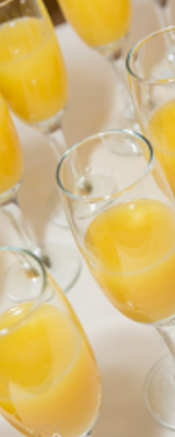 image of glasses of orange juice on tables at Roundwood in Norwich