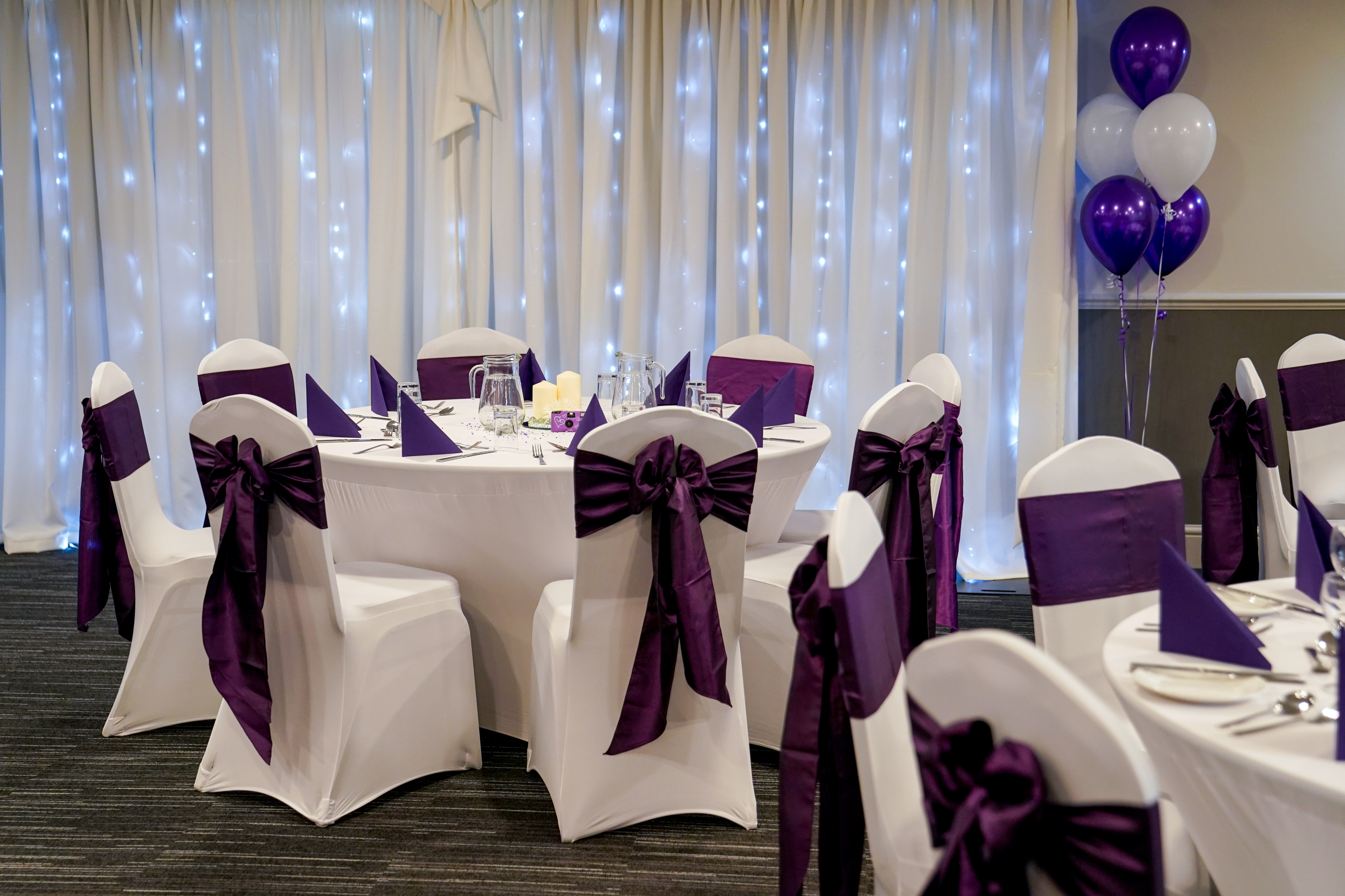 Add chair covers and our starlight backdrop