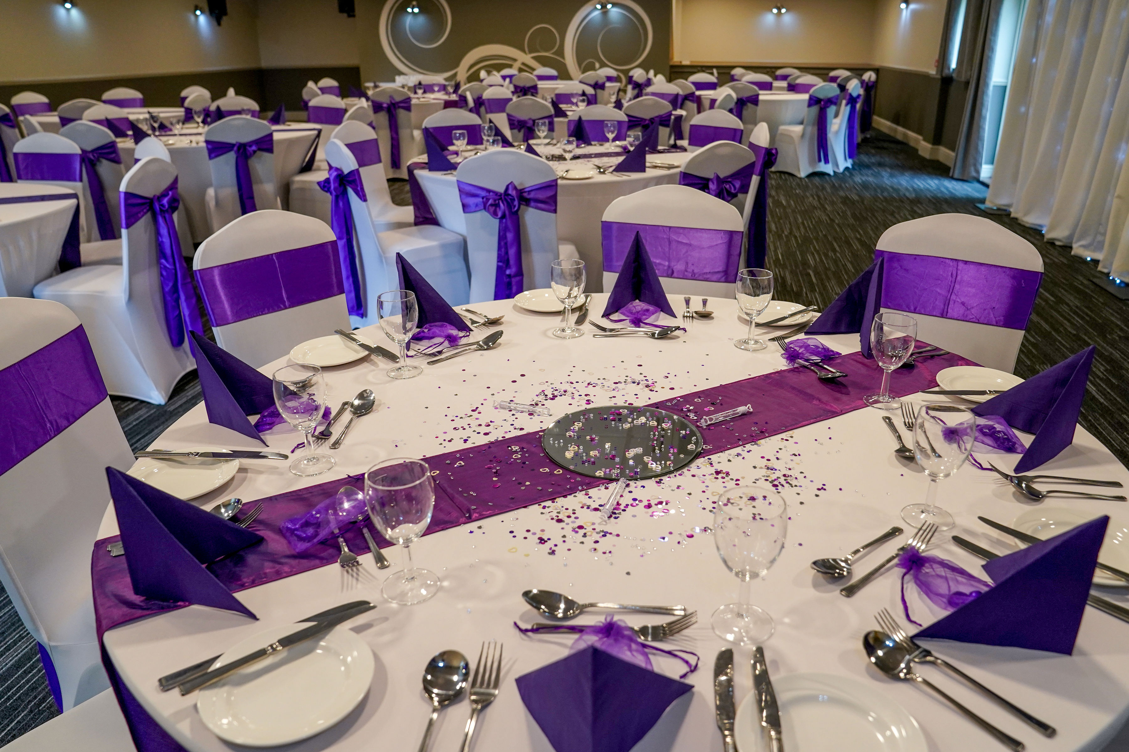 Table confetti and runners add impact